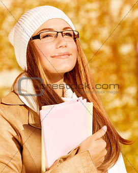 Portrait of student girl in autumn