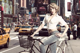 sensual blonde girl with bicycle