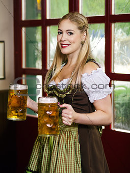 Oktoberfest waitress serving beer