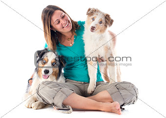 australian shepherds and woman