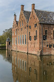 Old dutch mansion with reflection in the water