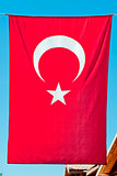 Turkish flag hanging vertically.