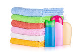 Cosmetics bottles and colored towels
