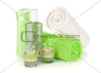 Bathroom bottles, towels and candles