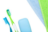 Toothbrushes, soap and towels