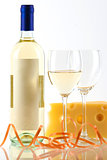 Bottle of white wine, wine glasses and cheese