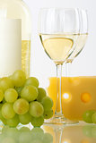 Bottle of white wine, wine glasses, grape and cheese