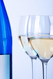 Blue bottle of white wine and two wine glasses