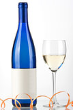 Blue bottle of white wine and wine glass