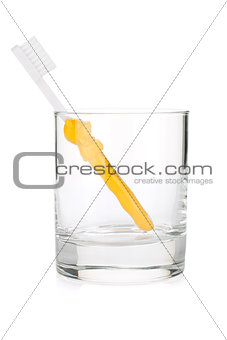 Baby toothbrush in a glass