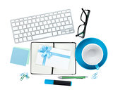 Coffee cup, office supplies and letter