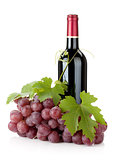 Red wine bottle and grapes