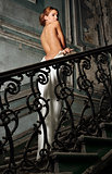 beautiful woman in white dress with naked back in palace.