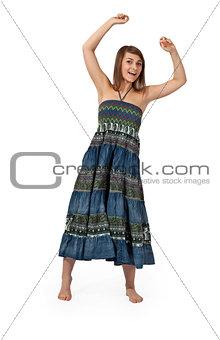 beautiful girl in jeans sarafan dancing