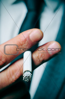 man in suit smoking