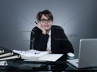 business woman listening looking at camera