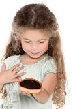 Little girl portrait showing chocolate pie