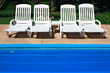 white deckchair by the pool