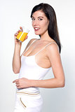 young caucasian woman drinking orange juice