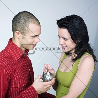 young couple saving