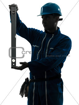 man construction worker holding level silhouette