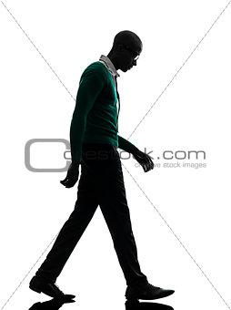 african black man walking looking down sad silhouette