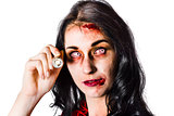 Zombie woman holding flashlight on white