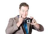 Funny man gesturing big smile with vintage camera
