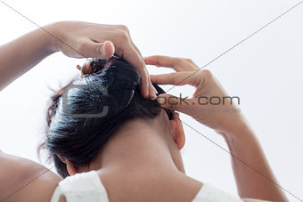 Beautiful Indian women styling her hair