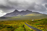 Cuillin Hills mountains with lonely house and road, Scotland