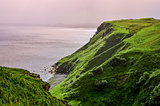 Ocean coastline with green cliffs in Scottish highlands