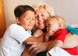 Happy grandmother hugging with her grandsons
