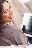 Hispanic Woman Laughing Using Tablet Computer