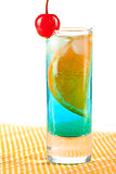 Alcohol cocktail with blue curacao, orange and maraschino