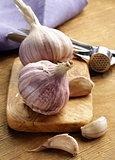whole garlic bulbs on a cutting board