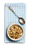 muesli in bowl and silver spoon