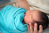 Newborn Asian baby girl in hospital