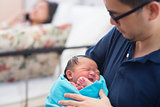 Newborn Asian baby girl and parents