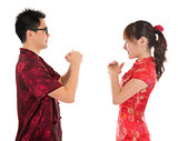 Chinese cheongsam people respecting to each other