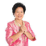Oriental senior woman greeting