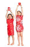Happy Asian children holding red packet