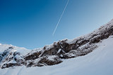 Mountain Peak and Airplane Trail near Megeve in French Alps, Fra