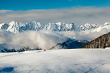 Panoramic View on Mountains and Two People Walking in French Alp