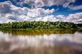 Stripe of Forest Between Cloudy Sky and the River near Moscow, V