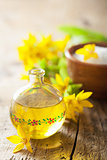 essential oil and yellow flowers for spa