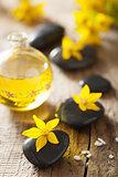 spa stones essential oil and yellow flowers for spa