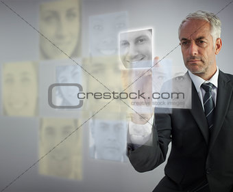 Stern human resources director selecting future employees