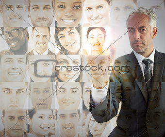 Serious businessman choosing future employees