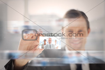Pleased businessman presenting a picture of a business team