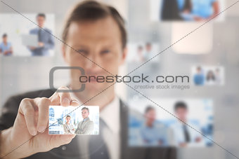 Pleased businessman picking a picture